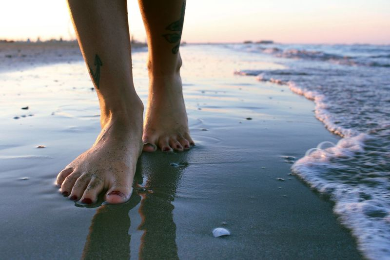 Impronte 👣 Colors Sun Summer Feet Beach Water Sea Land Low Section Sand Human Leg Human Foot One Person Lifestyles Sky Body Part