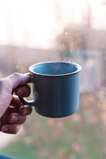 Cup Drink Food And Drink Mug Refreshment Focus On Foreground Close-up Tea Cup Human Hand Hand One Person Holding Human Body Part Real People Lifestyles Day Unrecognizable Person Coffee Cup Body Part Coffee Finger Human Limb