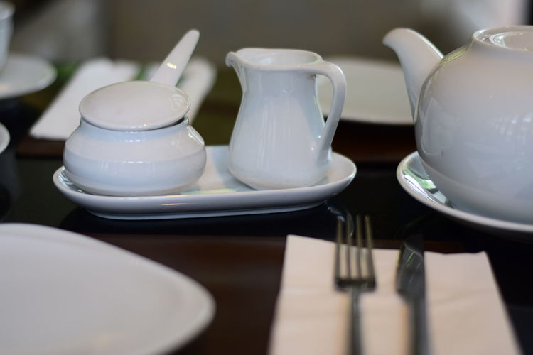 Close-Up Of Porcelain Utensils On Table