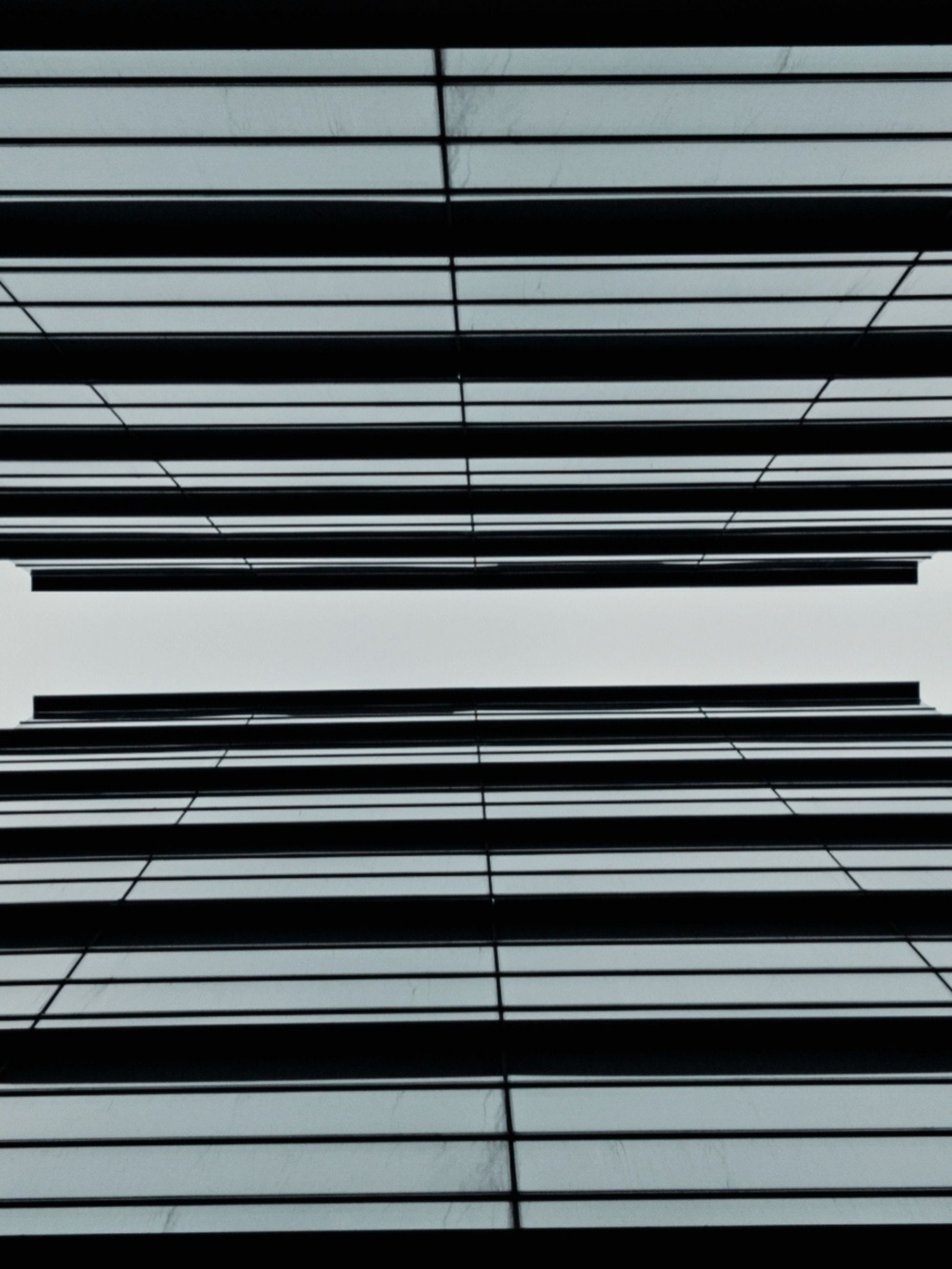pattern, full frame, line, no people, backgrounds, black and white, black, architecture, built structure, monochrome, repetition, interior design, metal, monochrome photography, indoors, striped, day, in a row, font, close-up, window covering, low angle view, blinds, wall - building feature