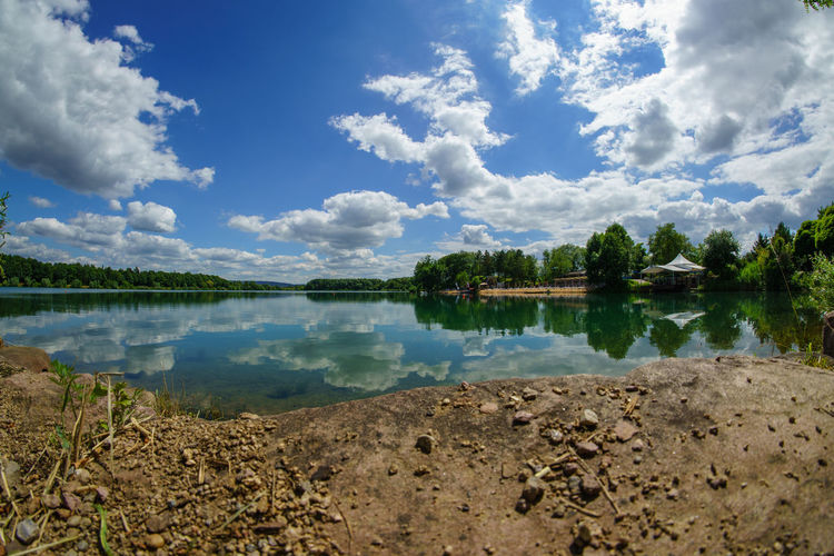 Niedernberg Beauty In Nature Blue Calm Cloud Cloud - Sky Cloudy Day Idyllic Lake Lakeshore Landscape Nature No People Non-urban Scene Outdoors Plant Reflection Remote Scenics Sky Standing Water Tranquil Scene Tranquility Tree Water