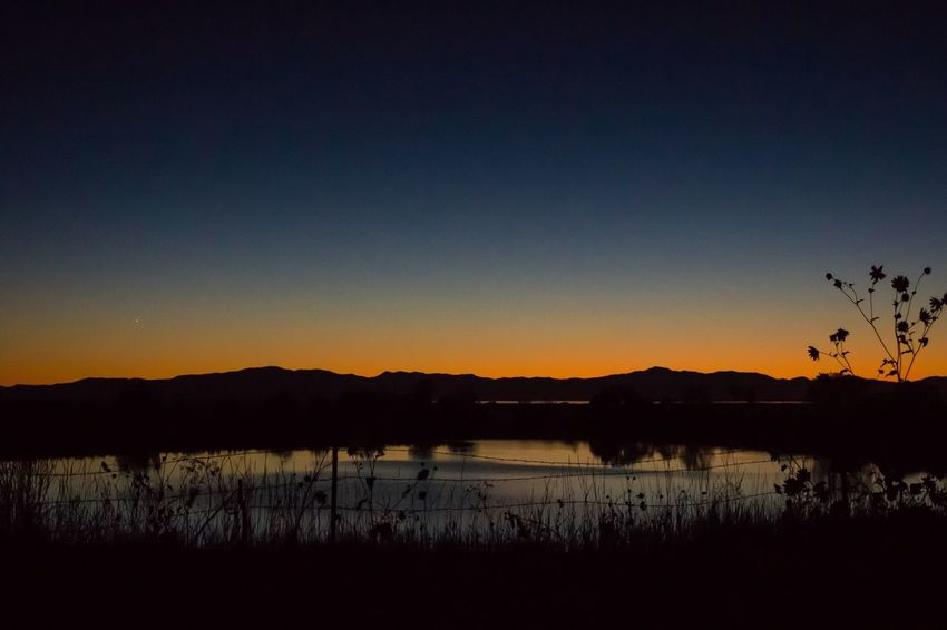 Silhouette Lake Sunset Water Scenics Tranquil Scene Copy Space Tranquility Mountain Clear Sky Dark Majestic Beauty In Nature Glowing Idyllic Plant Nature Atmosphere Non-urban Scene Mountain Range Overnight Success