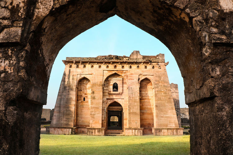 An equation of frames. Arch Architecture History Travel Destinations Monument Built Structure Old Ruin Day Grass Outdoors No People The Week On EyeEm EyeEmNewHere Frame In Frame Front View Indian Culture  India Madhyapradesh Mandu Fort
