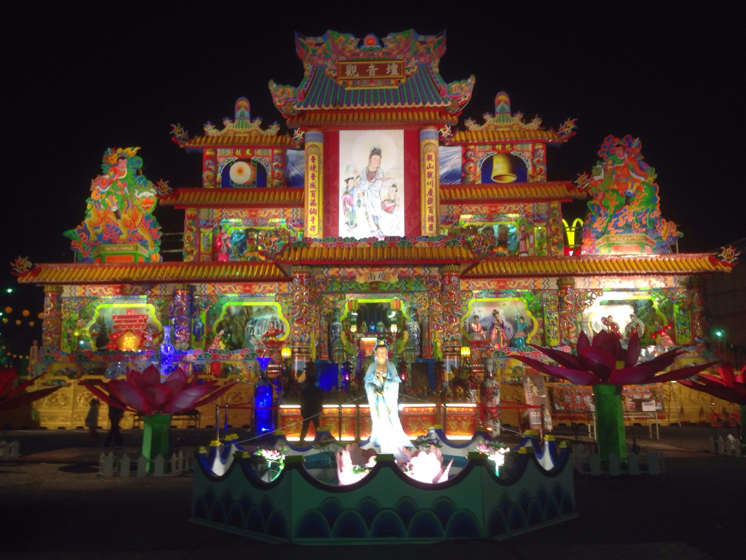 illuminated, night, architecture, religion, place of worship, art and craft, built structure, art, building exterior, decoration, creativity, spirituality, sculpture, multi colored, statue, celebration, famous place, arts culture and entertainment, human representation, animal representation