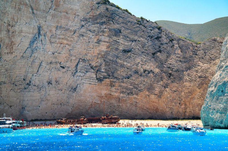 Cliff by sea at navagio beach