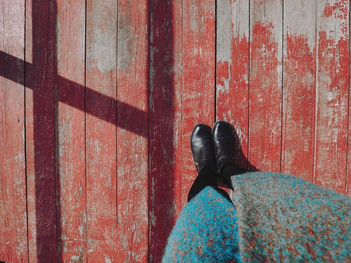 Girl's feet against a shabby red wooden floor. Feet Feets Shadow Wood Wood - Material Wooden Wooden Texture Wood Paneling Red Red Color Grunge GrungeStyle Selfie ✌ Individuality Looking Down Leg Legs_only Legs Legsselfie Textured  Texture Woodpile EyeEm Selects Low Section Women Pattern Standing Red Close-up Exterior