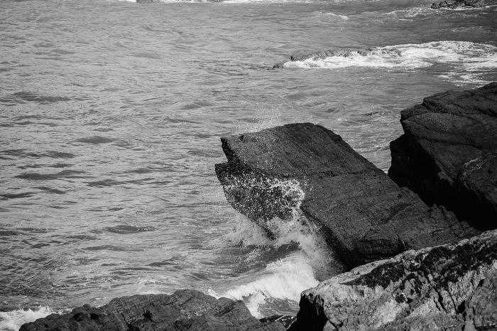 Beauty In Nature Black & White Black And White Coastline Coastline Day Idyllic Landscape Motion Nature No People Ocean Outdoors Power In Nature Rippled Rock Rock Formation Rocks Scenics Sea Spray Tranquil Scene Monochrome Photography Water Wave
