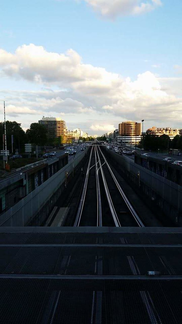 HIGH ANGLE VIEW OF RAILROAD STATION PLATFORM AGAINST SKY