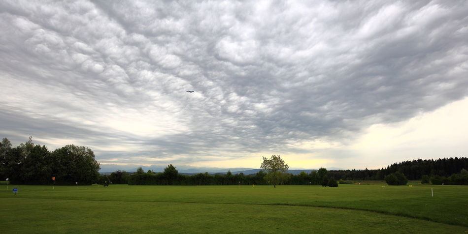 Cloudscape over golf course. Bad Weather Clouds Cloudscape Eye4photography  EyeEm Best Shots EyeEm Gallery EyeEm Nature Lover Golf Golfcourse Grass Green Landscape Lines Majestic Menace Panorama Silence Before The Storm Sport Storm Transitional Moments Trees Wind