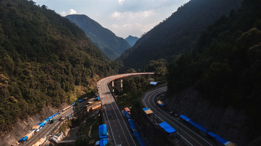High angle view of highway by mountains