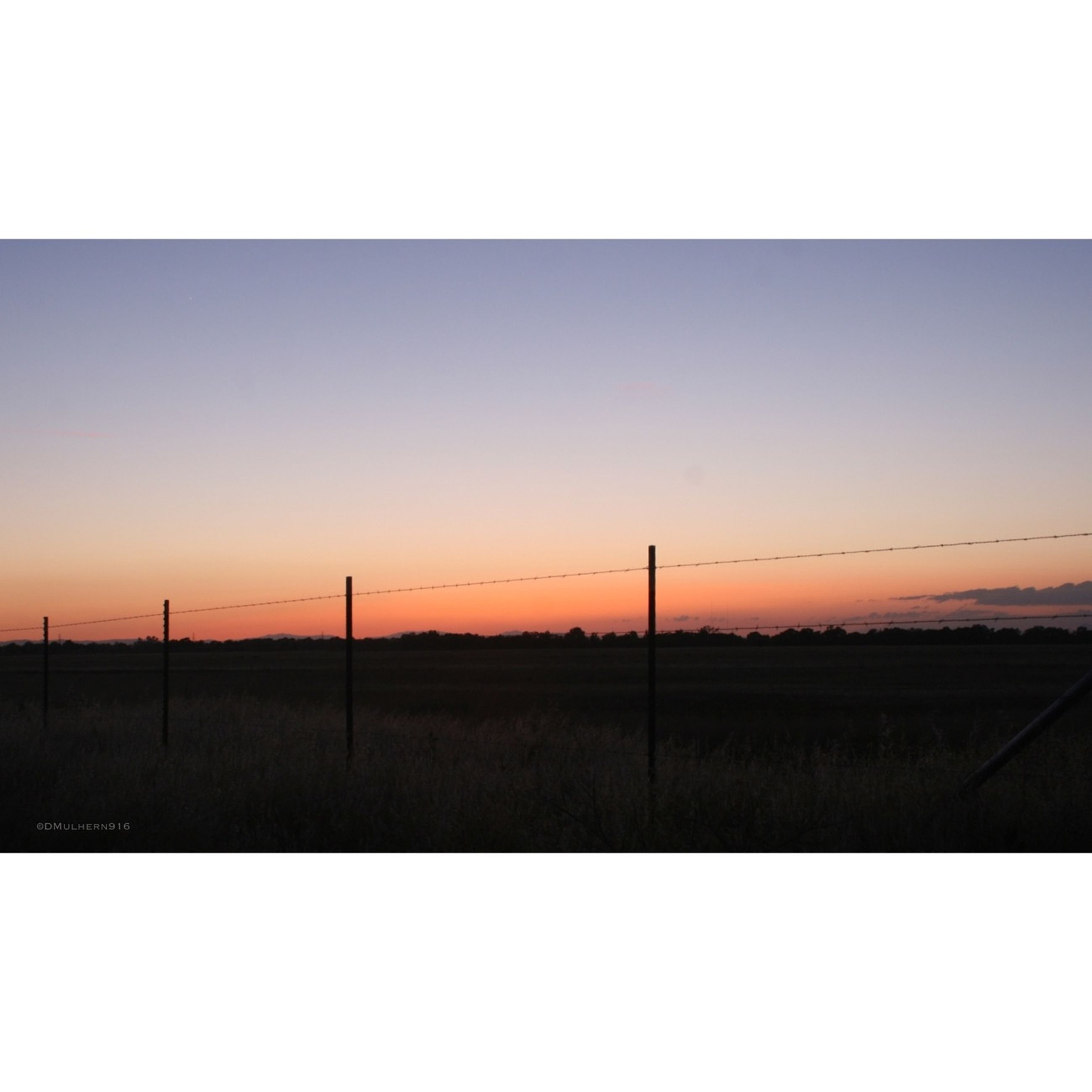 sunset, landscape, field, copy space, tranquil scene, silhouette, tranquility, scenics, clear sky, orange color, transfer print, sky, beauty in nature, horizon over land, nature, electricity pylon, rural scene, auto post production filter, outdoors, grass