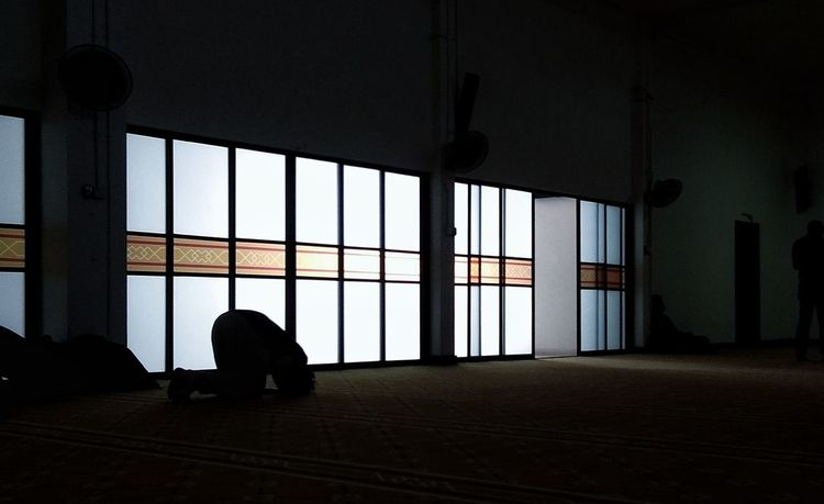 A Muslim prays in Mosque Indoors  Window Silhouette Architecture Adult People Day One Person Worshippers Worshiping God Muslim Pray Solat Takbir Sujood #FREIHEITBERLIN
