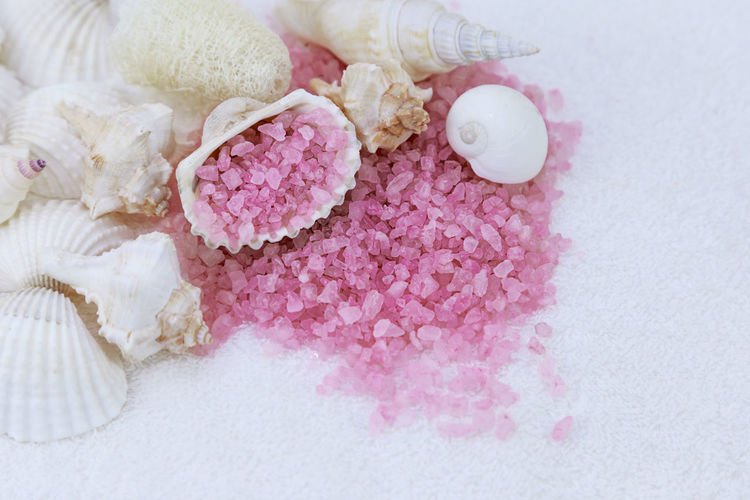 pink sea salt and seashells scattered on a terry towel, concept - body care Flat Lay Top View Nobody No People Relax Aromatherapy Natural Pink Salt Therapy Wellness Alternative Medicine Beauty Care Crystal Health Healthy Heap Indoors  Ingredient Mineral Organic Pampering Pink Color Sea Salt Seashell Shell Spa Still Life Towel Treatment