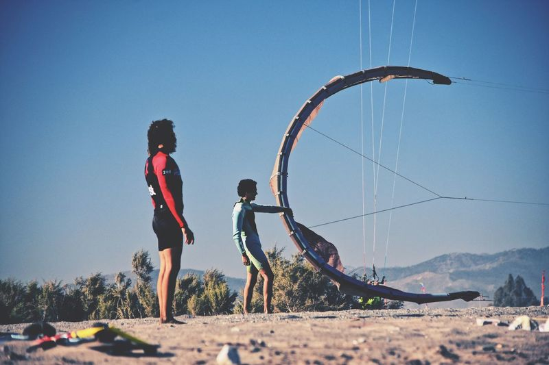 Wild wind Seaside Kitesurfing Leisure Activity Men Lifestyles Sky Full Length Two People Childhood Nature Real People Sport Summer Sports