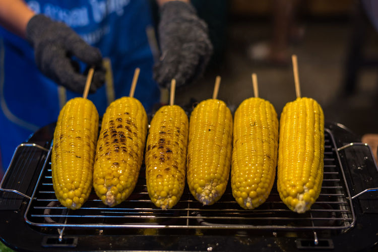 Barbecue Barbecue Grill Close-up Corn Corn On The Cob Focus On Foreground Food Food And Drink Freshness Grilled Healthy Eating Heat - Temperature Holding Midsection One Person Outdoors Preparation  Preparing Food Real People Sweetcorn Vegetable Yellow