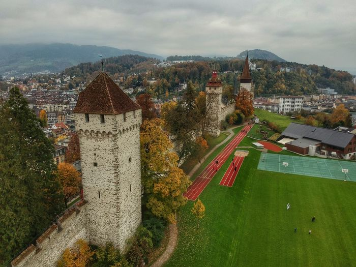 The towers at Museggmauer - Lucerne, Switzerland 2018 Switzerland Musegg Wall Museggmauer DJI X Eyeem Dji Spark Dronephotography Architecture Building Exterior Built Structure Sky City Cloud - Sky Nature Building Cityscape No People Outdoors Tree Day Environment Mountain Land High Angle View Plant Scenics - Nature Beauty In Nature