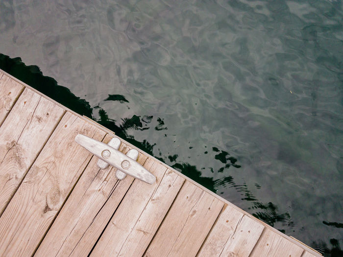 High angle view of text on pier over lake