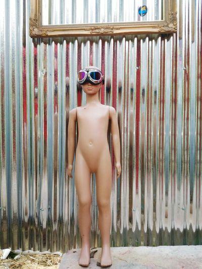 Sunglasses in figurine against corrugated iron