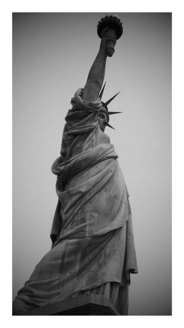 statue, female likeness, sculpture, human representation, low angle view, travel destinations, monument, crown, no people, architecture, sky, day, outdoors, representing, city