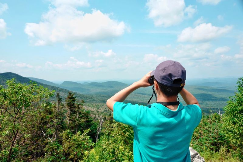 Outdoor Travel Photography Travel Destinations Lookout Mountain Lookout Point Lookout Looking Telescope View Telescope Mountains And Sky Mountain View Mountain Peak Mountains Cloud - Sky Plant Real People Beauty In Nature Leisure Activity Sky Scenics - Nature Nature Lifestyles Casual Clothing Rear View Green Color Tranquil Scene Standing Tranquility Growth Hat