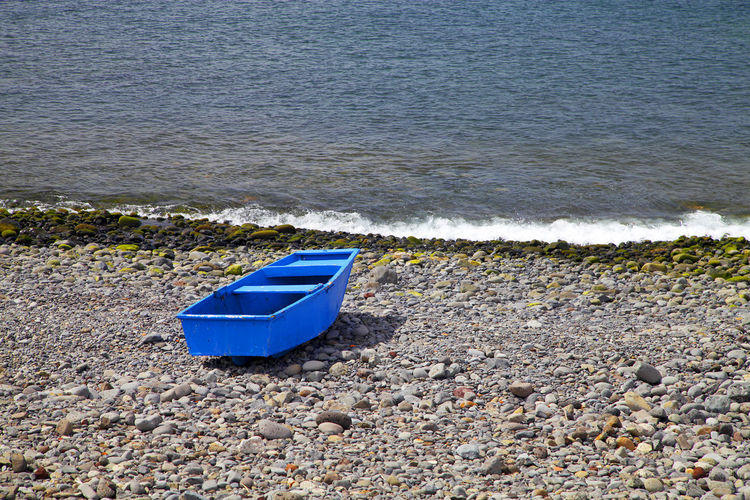 Blue Boat On Shore At Beach