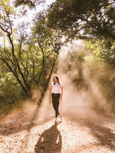 Beautiful rays shining upon an angel. Shot off iPhone Leaves Model Dust Forest Rays Of Light San Francisco One Person Plant Nature Tree Sunlight Lifestyles Full Length Outdoors Casual Clothing Standing Emotion Real People Shadow Motion Positive Emotion Day Water Leisure Activity
