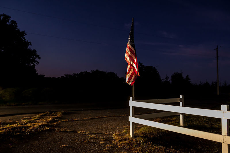 Low angle view of flag against sky at night