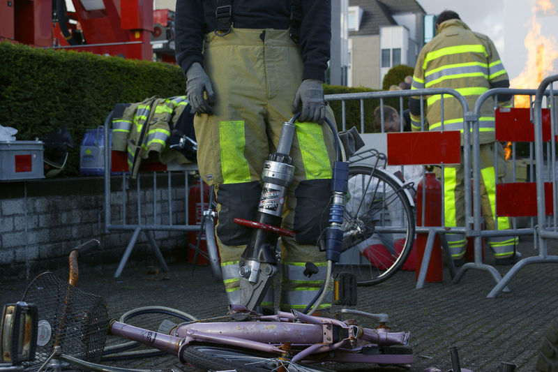 firefighter ready to cut trough a car with a hydraulic tool Firefighter Accidents And Disasters Adult Bicycle Cycling Day Hydraulic Hydrolic Low Section Men One Person Outdoors People Real People Sissors Tools