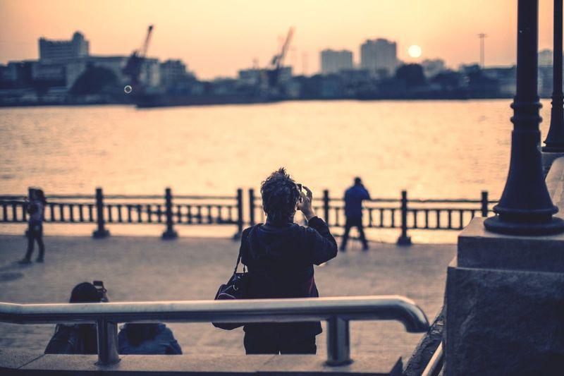 People at promenade in city