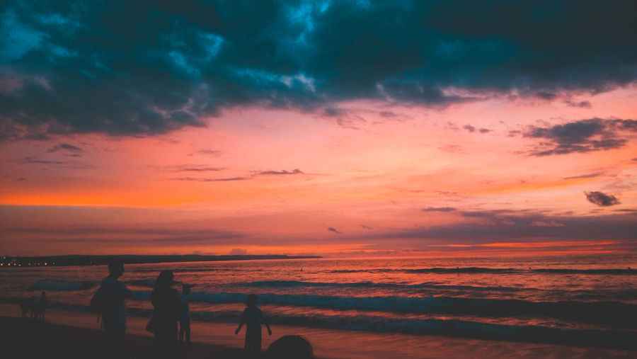 Sunset in Kuta Beach Bali, Indonesia Sky Sunset Cloud - Sky Beauty In Nature Silhouette Scenics - Nature Orange Color Horizon Over Water Sea Horizon Water Beach Nature Outdoors Looking At View Tranquility Land Lifestyles Leisure Activity Tranquil Scene First Eyeem Photo