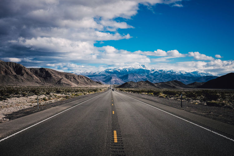 View of empty road passing through landscape