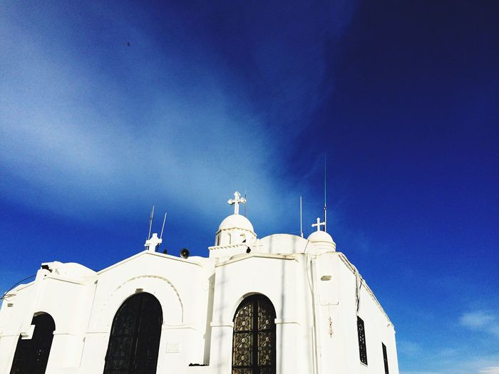 Low angle view of historic church against blue sky
