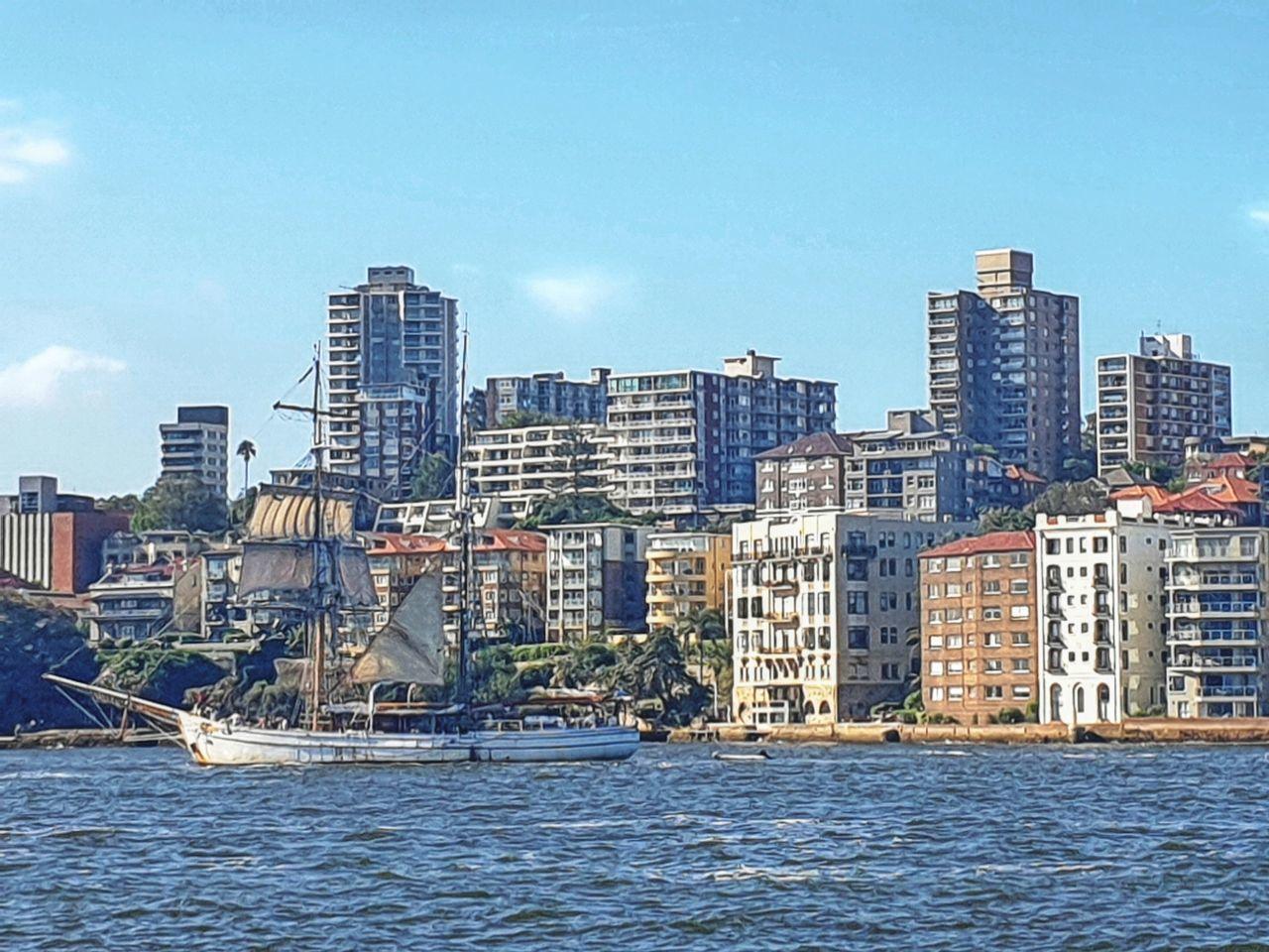 MODERN BUILDINGS BY CITY AGAINST SKY
