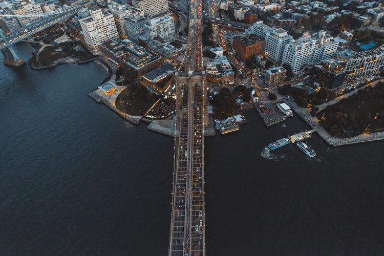 Aerial view of illuminated bridge over river in city