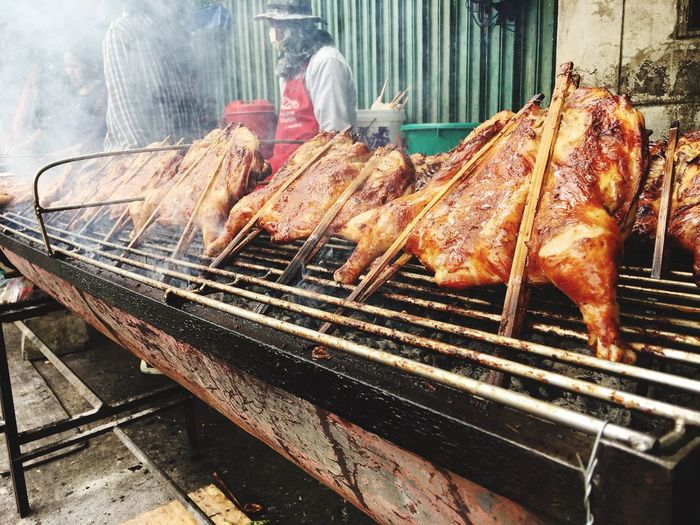 Roast Chicken Meat Food And Drink Grilled Preparation  Barbecue Food Outdoors Day Real People Metal Grate Men Freshness People