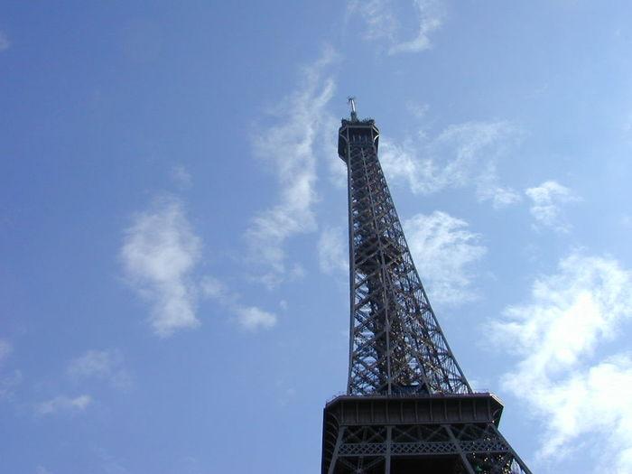 Paris Tour Eiffel Eiffel Tower Tour Eiffel, Paris. Blue Sky Blue Sky And Clouds Lookingup Tower Monument Landmark Tourism Traveling France Vive La France