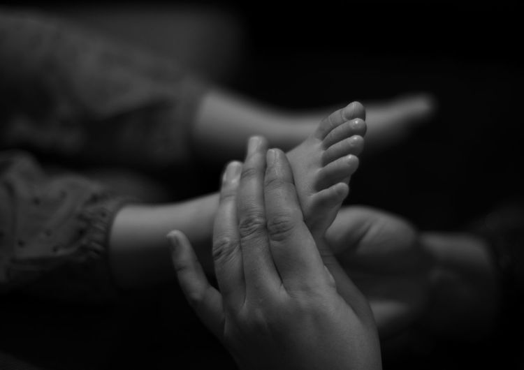Close-Up Of Mother Massaging Foot