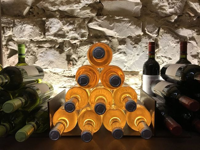 Alcohol Bottle Bottles Bottles And Light Close-up Day Drink Indoors  Large Group Of Objects Liqueur No People Stacked Bottles Wine Wine Bottle