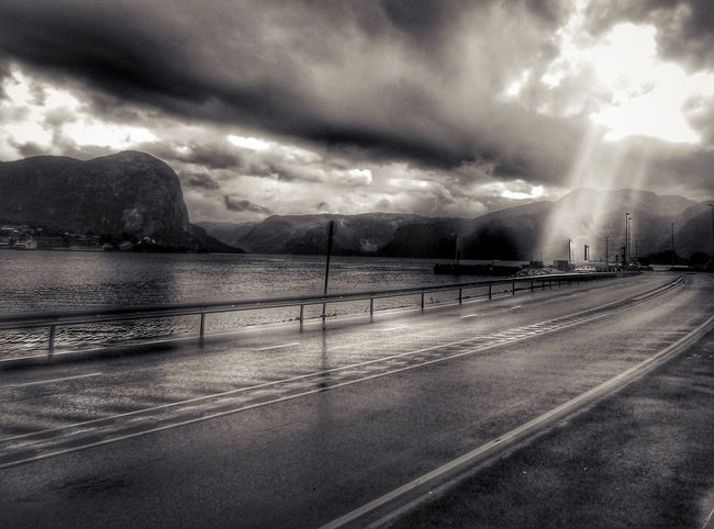 Norway Beauty In Nature City Cloud - Sky Crash Barrier Mountain Nature No People Outdoors Overcast Road Scenics - Nature Sky Storm Storm Cloud Sunbeam Tranquil Scene Tranquility Transportation Water