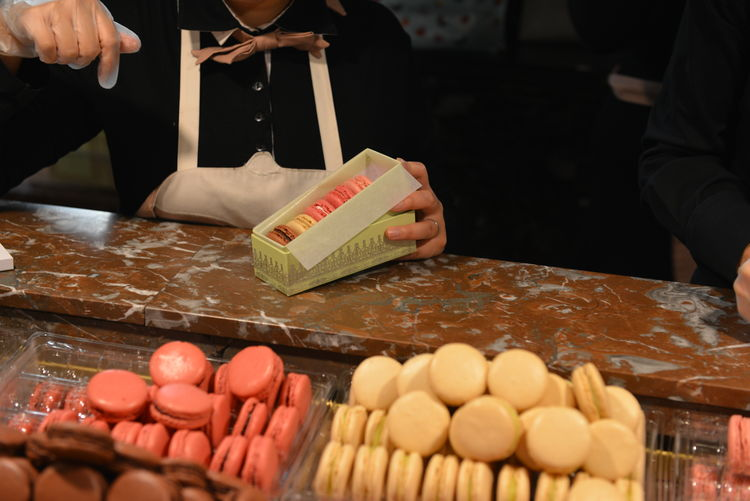 Food And Drink Laduree Macarons Business Food Food And Drink Foodphotography Freshness Hand Holding Human Body Part Human Hand Indoors  Market One Person Real People
