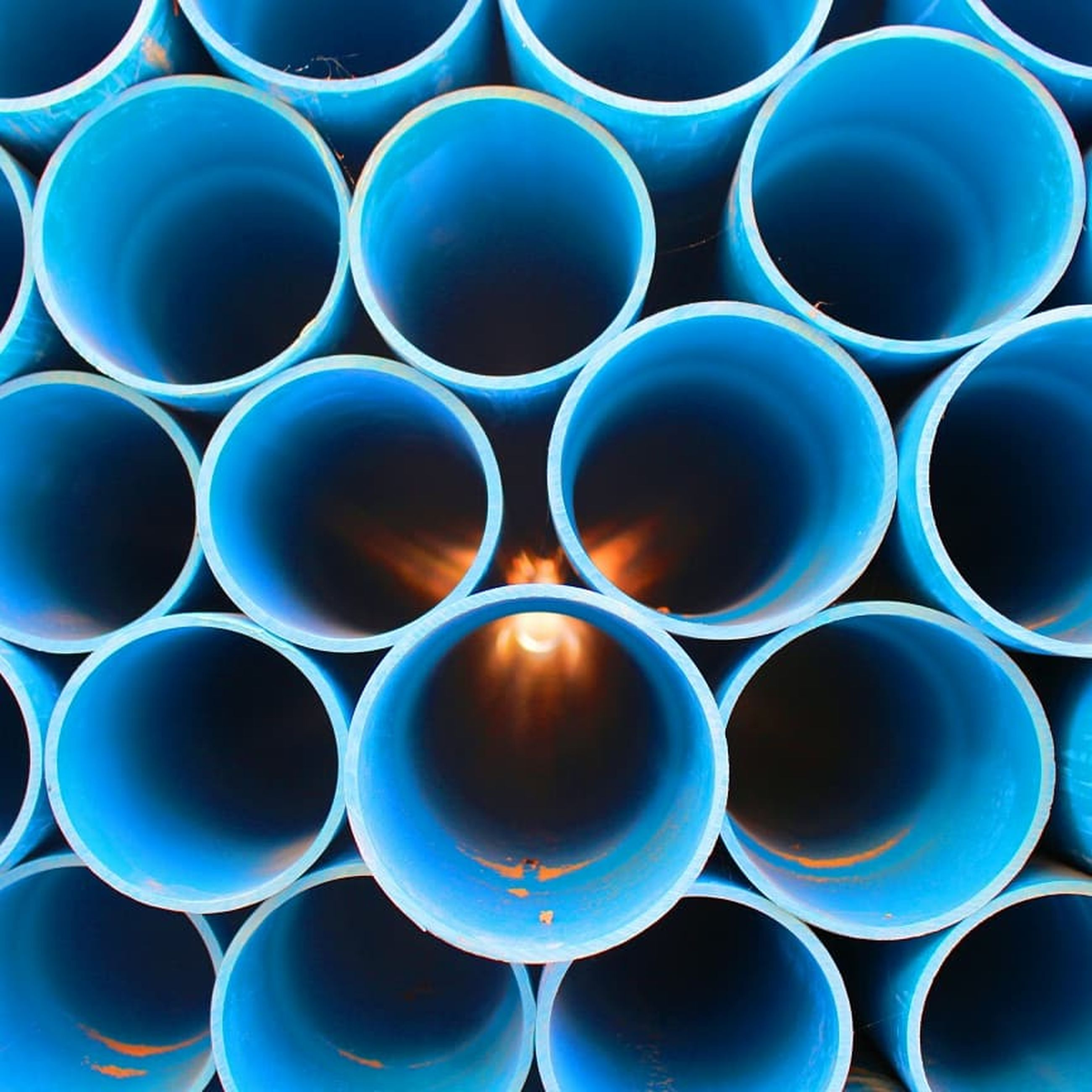 large group of objects, blue, stack, circle, pipe - tube, no people, shape, repetition, abundance, geometric shape, backgrounds, full frame, industry, pattern, tube, in a row, cylinder, close-up, arrangement
