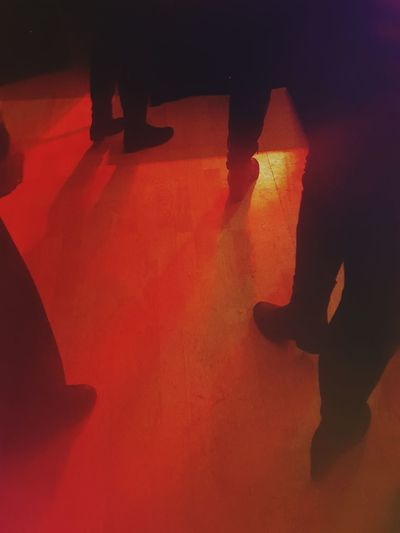 Low section of silhouette people standing on floor