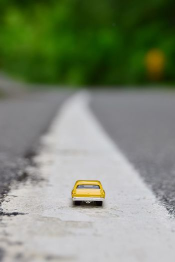 EyeEm Selects Transportation Yellow Mode Of Transportation Car Selective Focus City Toy Car Road No People Day Street The Way Forward Nature Motor Vehicle Land Vehicle Toy Outdoors Direction Diminishing Perspective Asphalt The Still Life Photographer - 2018 EyeEm Awards The Still Life Photographer - 2018 EyeEm Awards