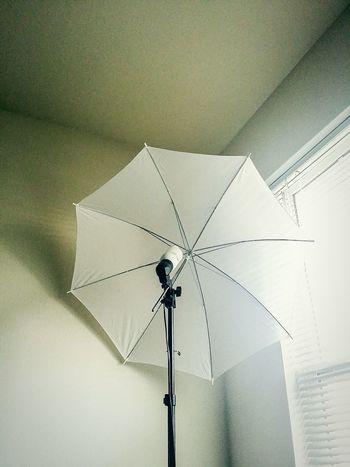 Lighting corner white room umbrella solace shadows