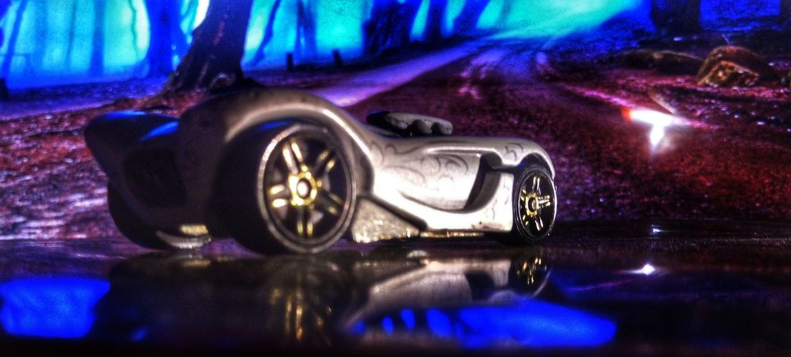 car at a turn Reflection No People Water Illuminated Night Close-up Multi Colored Indoors  Shape Car Light - Natural Phenomenon Wet Metal Number Lighting Equipment Architecture Nature Purple Drink