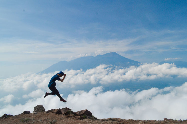 Sky Cloud - Sky One Person Mountain Leisure Activity Beauty In Nature Full Length Lifestyles Nature Real People Day Mid-air Adventure Scenics - Nature Side View Tranquil Scene Men Tranquility Jumping Mountain Range Outdoors