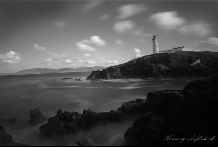 Fanad Head Lighthouse Blackandwhite Lighthouse Cloud - Sky Travel Destinations Direction Building Exterior Landscape Mountain Nature Water No People Outdoors