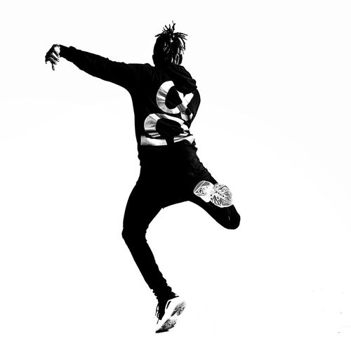Afrobeat Urban Culture  Art Afrobeat One Person Full Length Dancing Studio Shot Arts Culture And Entertainment Indoors  Lifestyles Young Adult Vitality White Background Flexibility Jumping