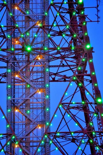 Illuminated Television Tower Against Blue Sky