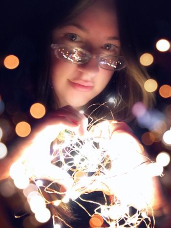 Night Illuminated Celebration One Person Real People Lifestyles Portrait Indoors  Young Adult Young Women Close-up People Lights Light And Shadow Heart Love Expression Expressive Emotive Ginacollins Self Portrait Heart Shape Handsigns Handinframe Selective Focus
